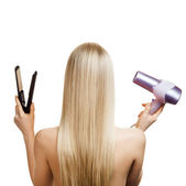 Blonde hair and hairdresser's tools — Stock Photo