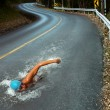 Strong Man Swim On Asphalt Road — Stock Photo