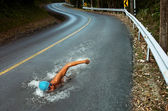 Strong Man Swim On Asphalt Road — Stockfoto