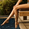Girl's beauty legs in the pool — Stock Photo