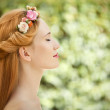 Beautiful young woman with flowers wreath in hair on natural gre — Stock Photo