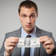 Portrait of a business man holding money — Stock Photo #26567927