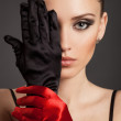 Fashion Portrait of a beautiful woman in gloves — Stock Photo
