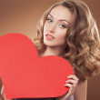 Stock fotografie: Valentines Day. Woman holding Valentines Day heart sign with cop