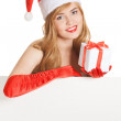 Young happy xmas woman with a gifts — Stock Photo #26568241