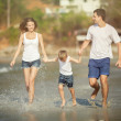 Young family play on beach — Stock Photo