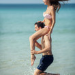 Stock Photo: Couple running on a tropical beach. Vacation