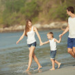Young family play on beach — Stock Photo #28732833
