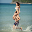 图库照片: Couple running on a tropical beach. Vacation