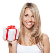 Young happy woman with a gift — Stock fotografie