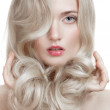 Beautiful Blonde Girl. Healthy Long Curly Hair. — Stock Photo #31147457