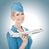 Charming Stewardess Holding Airplane In Hand. — Stock Photo
