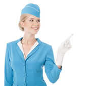 Charming Stewardess Dressed In Blue Uniform Pointing The Finger — Stock Photo