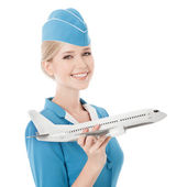 Charming Stewardess Holding Airplane In Hand. Isolated On White — Stock Photo
