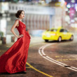 Young beauty famous woman in fluttering red dress, — Stock Photo #35782833