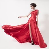 Young beauty woman in fluttering red dress. — Foto Stock