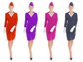 Encantadora aeromoça vestido com uniforme com variantes de cor. Isol — Fotografia Stock