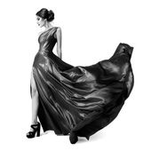 Fashion woman in fluttering dress. Black and white image. Isolat — Stock Photo