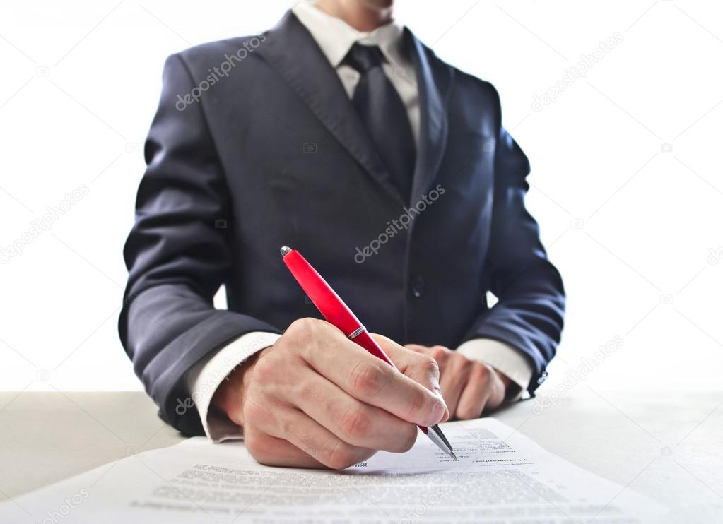 A businessman is signing a contract. — Stock Photo #12207787
