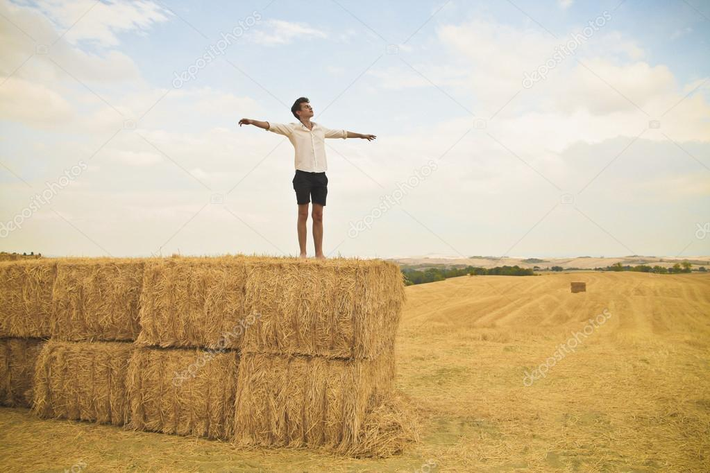 A boy is enjoying freedom over some sheafs. — Stock Photo #12231086