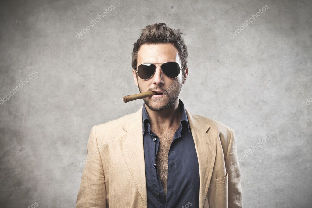 A young gangster with a cigar in his mouth.  Stock Photo #12389924