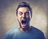 Mladý muž křičí — Stock fotografie