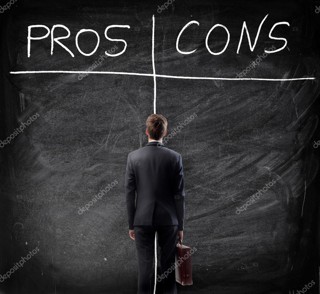 A businessman is considering the pros and cons of a deal.  Stock Photo #12569927