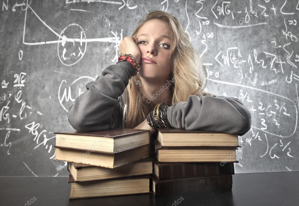 A girl is bored by the school  Stock Photo #12666215