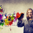 Blonde Girl Making a Graffiti - Stock Photo