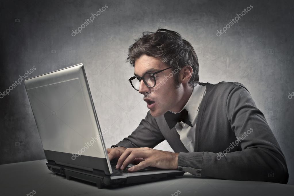 Fashionable boy using a laptop computer  Stock Photo #13163716