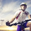Stock Photo: Cyclist on Sunset