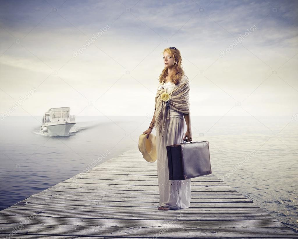 Blonde woman leaving with a boat  Foto de Stock   #14037346