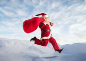 Running Santa Claus — Stock Photo
