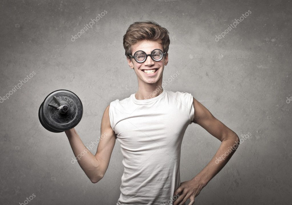 Nerdy guy with glasses and gym gear on gray background  Stock Photo #18062189