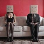 Happy couple on sofa — Stock Photo