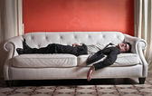 Businessman on sofa — Stock Photo