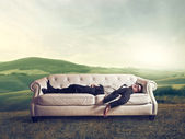 Empresario en sofá — Foto de Stock