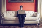 Businessman working on sofa — Stock Photo