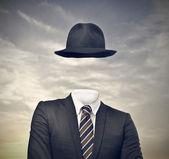 Niewiem biznesmen z kapeluszem — Zdjęcie stockowe