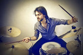 Man playing the drums — Stock Photo