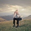 Man thinking on the top of a hill — Stock Photo #25200641