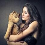 Woman holding a teddy bear — Stock Photo
