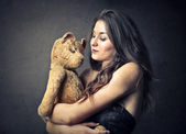 Woman holding a teddy bear — Stock Photo