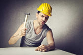 Bricklayer holding a hammer — Stock Photo