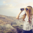 Beautiful woman with binoculars — Stock Photo #26863625