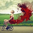 Woman riding a bike — Stockfoto