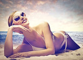 Beautiful woman sunbathing — Stock Photo