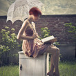Fashion woman reading a book — Stock Photo