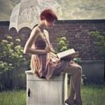 Fashion woman reading a book — Stock Photo #28926065