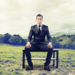 Businessman waiting sitting on a bench — Photo